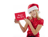 Smiling girl with a new year greeting card — Stock Photo