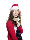 Beautiful young woman with credit cards looking away — Stock Photo