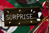 Close up image of surprise placard on gift box — Stock Photo