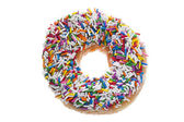 Donut with candy sprinkles — Stock Photo