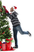 Man climbing christmas tree — Stock Photo