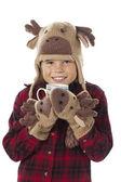 Portrait of a cute boy holding a mug of hot chocolate — Stock Photo