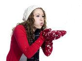 Pretty woman blowing snow — Stock Photo
