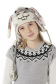 Portrait of a teenage girl in rabbit costume and head cocked — Fotografia Stock
