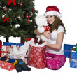 Smiling young woman with her christmas gift - Lizenzfreies Foto