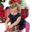 View of a cute baby girl opening a christmas gift box — Stock Photo