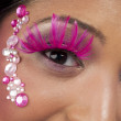 Close up of womans face with makeup and jewelry — Stock Photo #18742579
