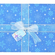 Close up image of blue gift box with snowman sticker — Zdjęcie stockowe