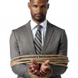 African american businessman wrapped in rope — Stock Photo