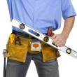 Royalty-Free Stock Photo: Construction worker with a level ruler