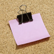 Pink post it paper with black paper clip — Stock Photo #18745715