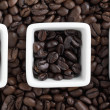 Stock Photo: Close up shot of coffee cup and beans