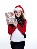 Smiling young female with her christmas gift — Stock Photo