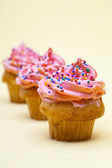 Strawberry cupcakes on a plain background — Stock Photo
