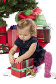 View of a cute baby girl opening a christmas gift box — Fotografia Stock
