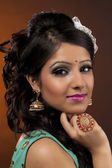 Beautiful indian woman with hand on chin — Stock Photo