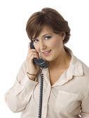 Beautiful woman answering phone — Стоковое фото
