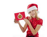 Beautiful girl holding a christmas greeting card — Stock Photo