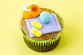 Close up image of a cupcake with decorative miniature toppings — Stock Photo