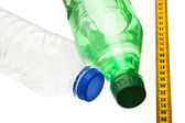 Bottles and measuring tape — Stock Photo