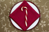 Candy cane with red table napkin — Stock Photo