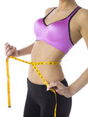 Measuring tape in waist of a lady — Stock Photo