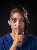 Portrait of injured with finger on lips — Stock Photo