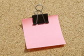Pink memo note with binder — Stock Photo
