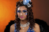 Portrait image of a attractive female wearing stage make up — Stock Photo