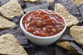 Blue nachos and tortilla chips with salsa dip — Stock Photo