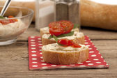 Bread with butter and tomatoes — Stock Photo