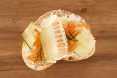 Bread with butter spread and smoked salmon — Stock Photo