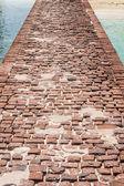 Brick bridge at the pier — Stock Photo