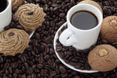 Coffee and coffee beans with cookies — Stock Photo