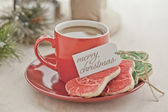 Coffee with a holiday tag and cookies — Stock Photo