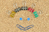 Happy face made of colorful clips — Stockfoto