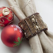 Bauble with napkin on plate - Stock Photo