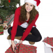 Stock Photo: Blonde lady cutting gift wrapper