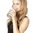 Royalty-Free Stock Photo: Beautiful girl holding a glass of water while smiling