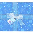 Close up image of blue gift box with snowman sticker — Stock Photo