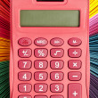 Close up shot of a calculator and color palette — Stock Photo