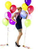 Woman kissing balloon — Stock Photo