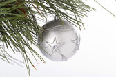Star shape on christmas bauble hanging on christmas tree — Stock Photo