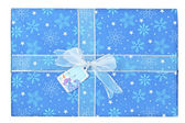 Close up image of blue gift box with snowman sticker — Foto de Stock