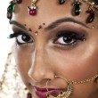 Attractive young female wearing wedding jewelry — Stock fotografie
