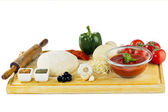 Complete set of ingredients for home made pizza — Stock Photo