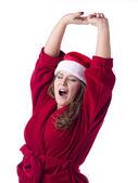 A yawning santa woman — Stock Photo