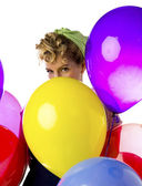 Blonde woman with balloons — Stock Photo