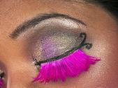 Close up shot of females eye with mascara pink eye lashes and ey — Stock Photo