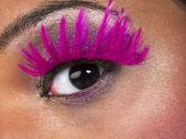 Close up shot of human eye with false eyelashes — Stock Photo